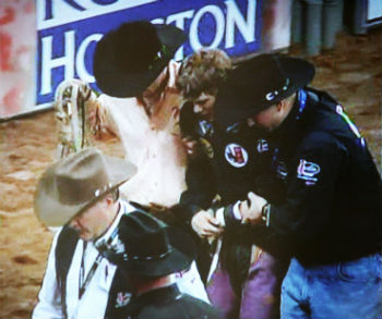 doctor assisting rodeo cowboy